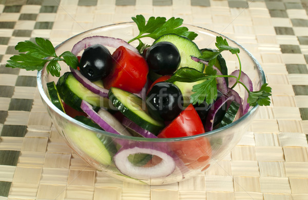 Stock photo: Salad in a glass bowl on a wooden base