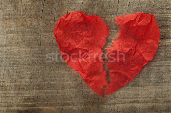 Heartbreak made of curled red paper Stock photo © deyangeorgiev