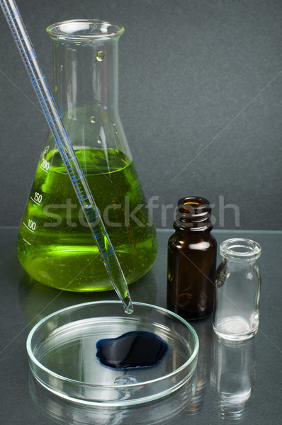 Laboratory beaker filled with green color liquid substances Stock photo © deyangeorgiev