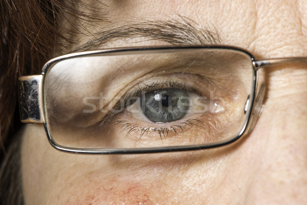 Close up old women eye and glasses Stock photo © deyangeorgiev