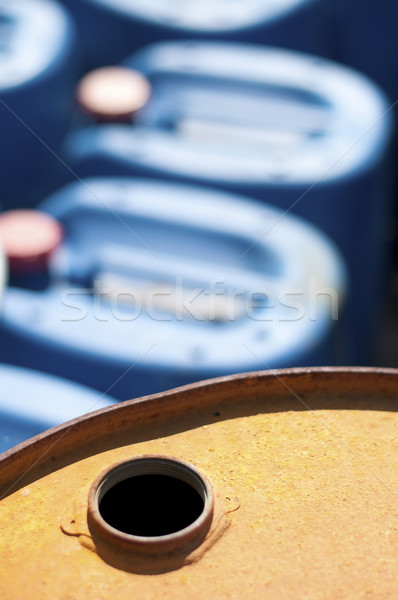 Old colored oil barrels and blue canisters Stock photo © deyangeorgiev