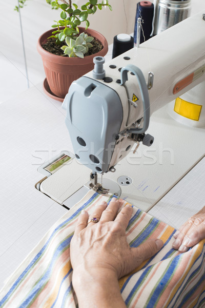 Women sew on sewing machine Stock photo © deyangeorgiev