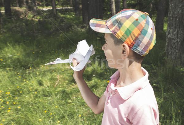 Criança jogar cegonha papel floresta sorrir Foto stock © deyangeorgiev