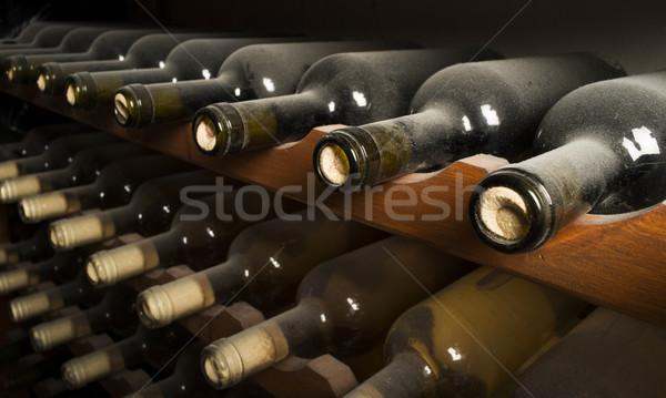Vinho garrafas prateleira adega vidro Foto stock © deyangeorgiev