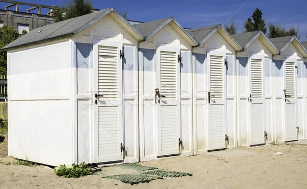 Wooden cabins on the beach Stock photo © deyangeorgiev