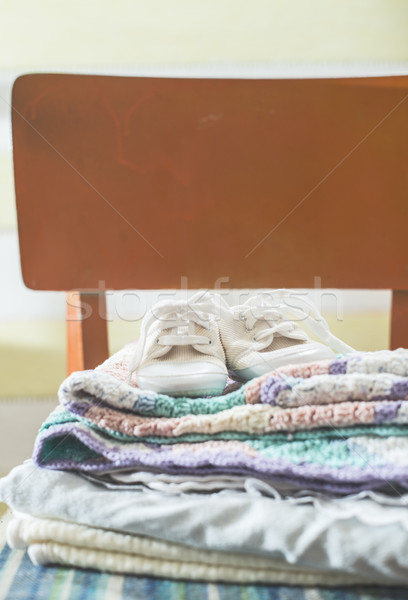 Baby blankets and shoes on chair Stock photo © deyangeorgiev