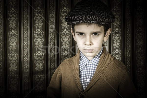 Frowning child in vintage clothes and hat Stock photo © deyangeorgiev
