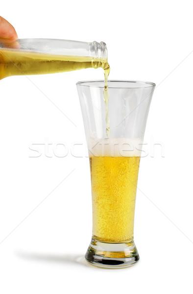 Hand holding bottle of beer and beer mug Stock photo © deyangeorgiev