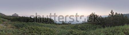 Sunrise in the mountain and hut. Panoramic image Stock photo © deyangeorgiev