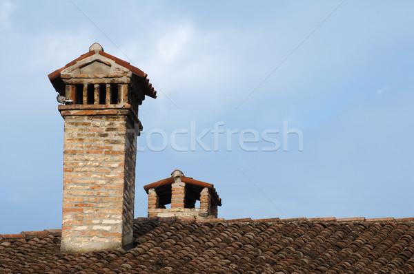 Schoorsteen dak oude kerk blauwe hemel exemplaar ruimte Stockfoto © deyangeorgiev