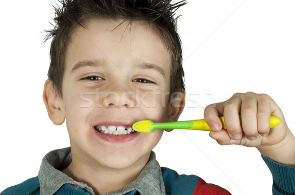 Boy brushing his teeth Stock photo © deyangeorgiev