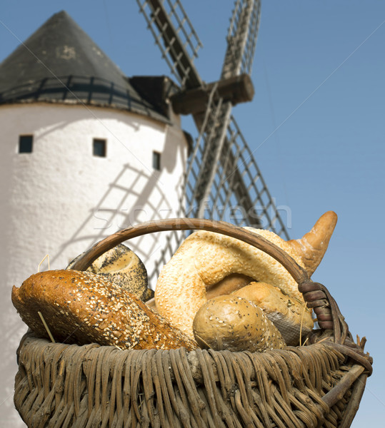 Different breads and windmill in the background Stock photo © deyangeorgiev