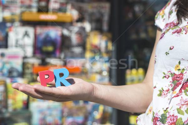 Women hold wooden letters PR Stock photo © deyangeorgiev
