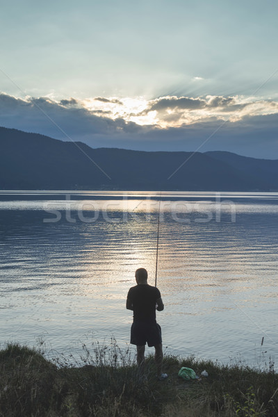 Silhouet visser berg sport zonsondergang zomer Stockfoto © deyangeorgiev