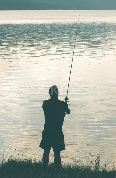 Silhouette of fisherman Stock photo © deyangeorgiev