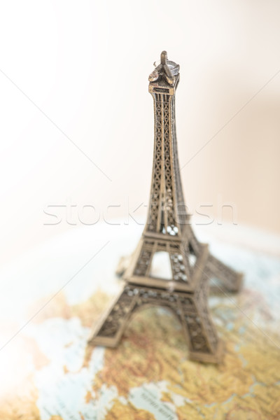 Eiffel Tower on globe. Stock photo © deyangeorgiev