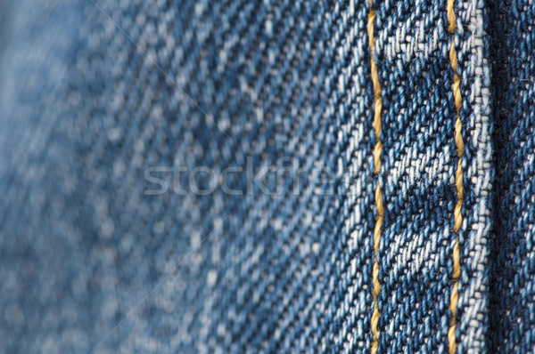 Orange stitch on the denim garment Stock photo © deyangeorgiev