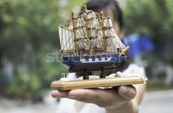 Modell vitorlás hajó kéz tart fa tenger Stock fotó © deyangeorgiev