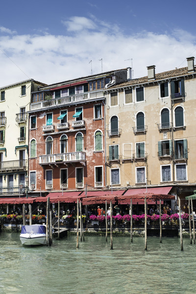 Stock photo: Ancient buildings and boats in the channel in Venice