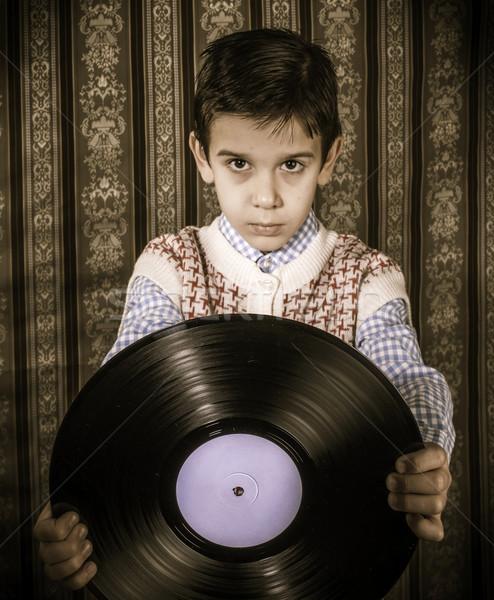 Child hold lp Stock photo © deyangeorgiev