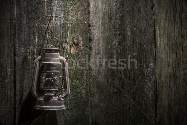 Old gas lantern on wood Stock photo © deyangeorgiev