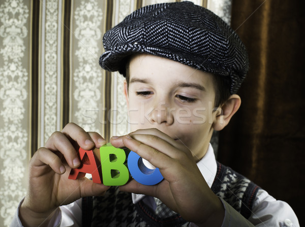 Child in vintage clothes hold letters a b c Stock photo © deyangeorgiev