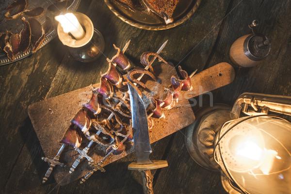 Dried meat on wooden table Stock photo © deyangeorgiev