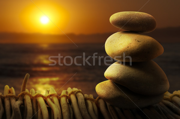 Stacked stones on wooden base for spa Stock photo © deyangeorgiev