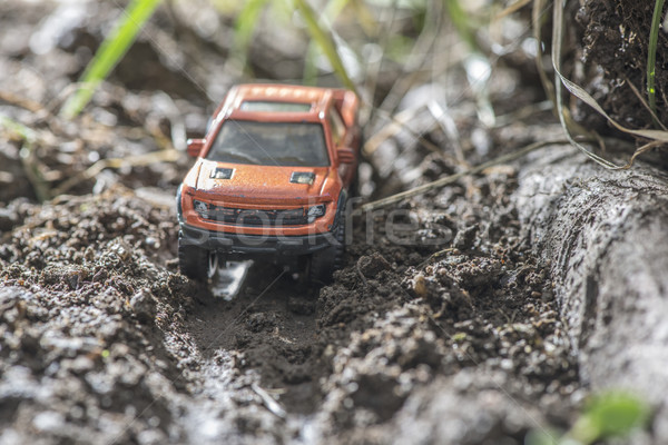 Small red off road car toy in the nature. Stock photo © deyangeorgiev