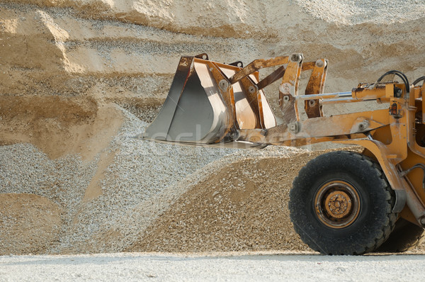 Buldózer hatalmas köteg mészkő homok építkezés Stock fotó © deyangeorgiev