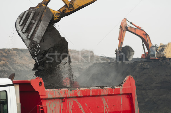 Excavator loading truck Stock photo © deyangeorgiev