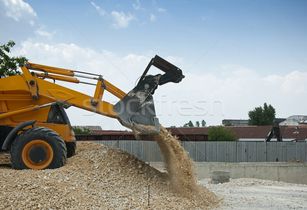 Excavator unload gravel Stock photo © deyangeorgiev