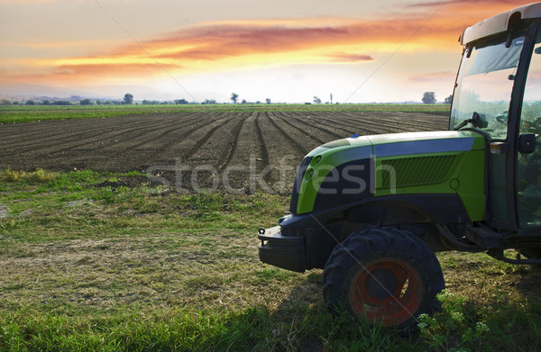 Plowed land and tractor Stock photo © deyangeorgiev