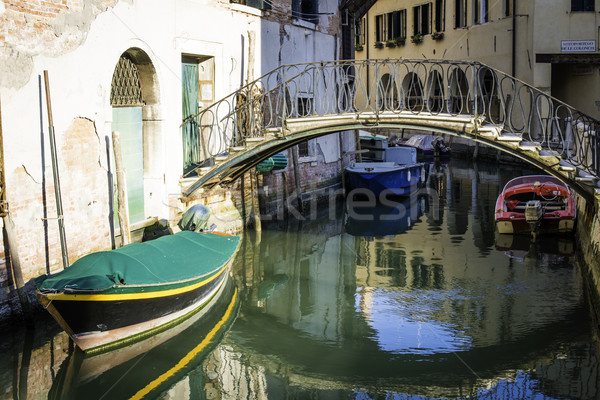 Stock photo: Ancient buildings in the channel in Venice.