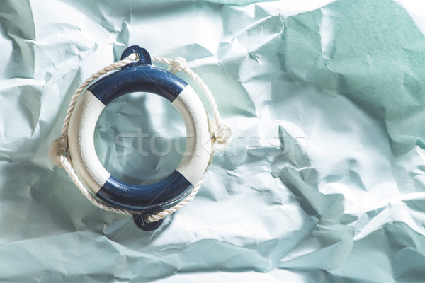 Lifebelt on blue background Stock photo © deyangeorgiev