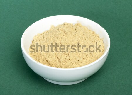Powdered ginger in a bowl and whole ginger Stock photo © deyangeorgiev