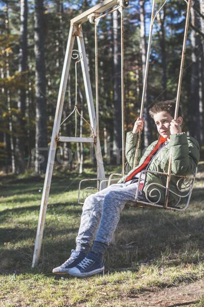 Child on a swing Stock photo © deyangeorgiev