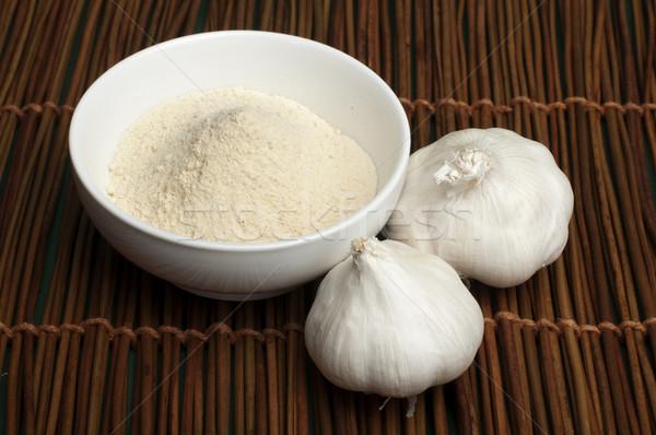 Crushed garlic powder and whole garlic Stock photo © deyangeorgiev