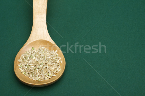 Rice integral in wooden spoon Stock photo © deyangeorgiev