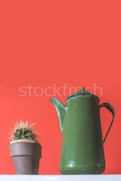 Zöld klasszikus bogrács piros fal kávé Stock fotó © deyangeorgiev