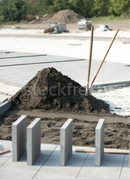 Tiling of pavement and sand pile Stock photo © deyangeorgiev