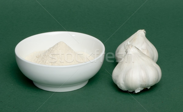 Crushed garlic powder and whole garlic Stock photo © deyangeorgiev