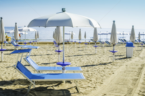 Guarda-chuvas praia azul água sol mar Foto stock © deyangeorgiev