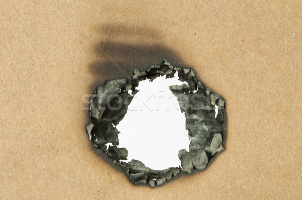Burned paper and hole Stock photo © deyangeorgiev