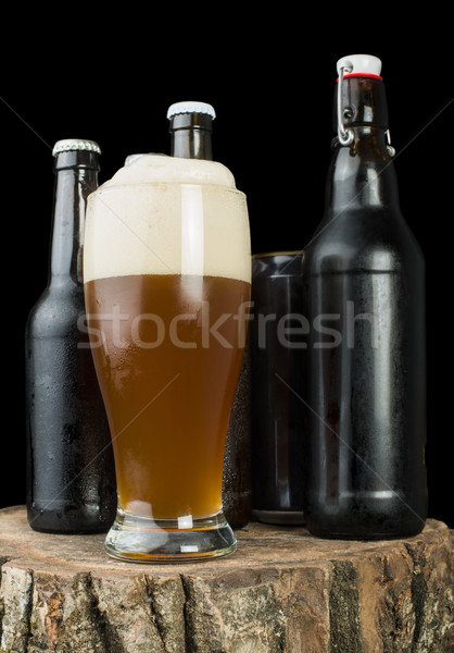 Bottles of beer and beer mug on stump Stock photo © deyangeorgiev