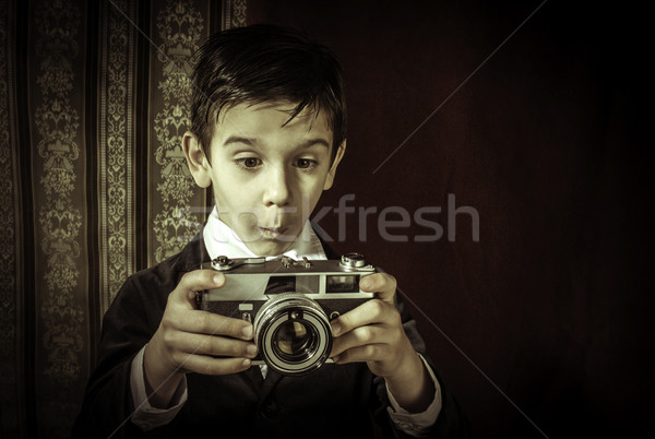 Child taking pictures with vintage camera Stock photo © deyangeorgiev