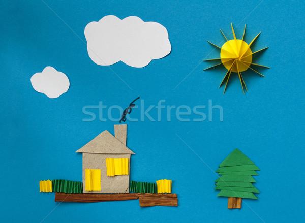 House made of paper over blue paper Stock photo © deyangeorgiev