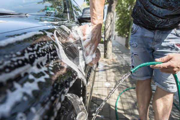 Men wash his car. Stock photo © deyangeorgiev