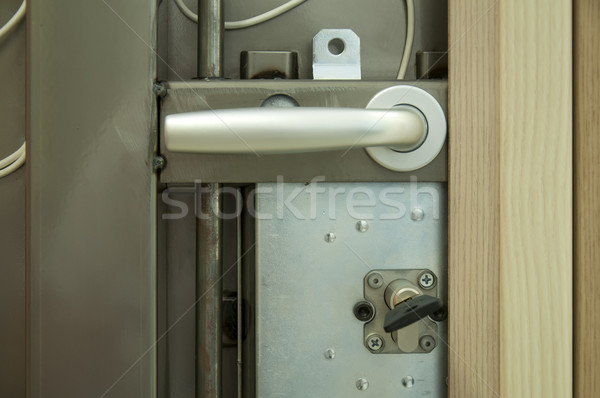 Exposed mechanism of armored door.