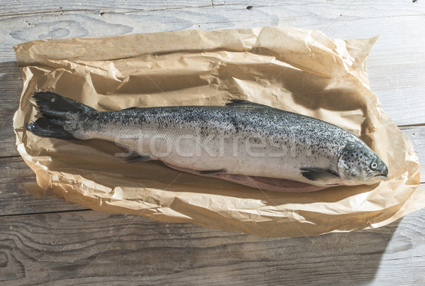 Raw fish wrapped in paper Stock photo © deyangeorgiev